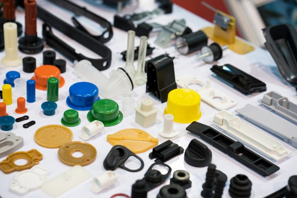 Plastic products displayed on a table to show the capabilities of what a plastic injection molding company can manufacture.